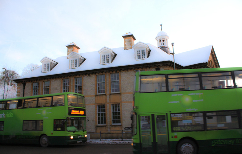 Green Bus in Snow